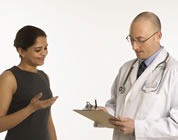 Asian woman with doctor